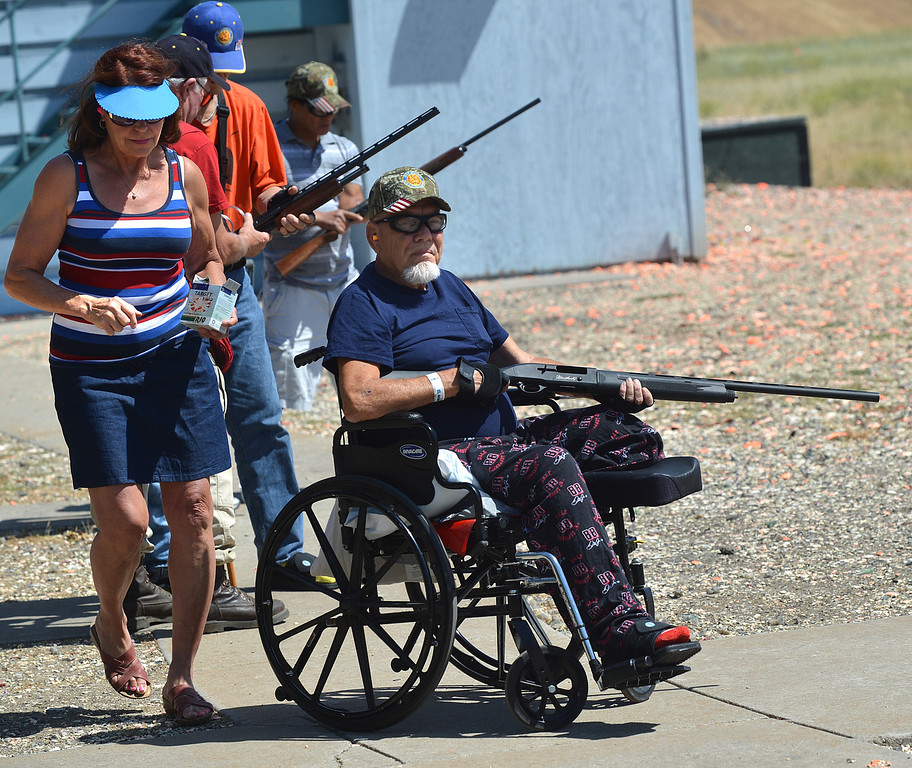 . Dorothy Bayer, of Antioch, left, helps coach Earl Batterton, of San Jose, a U.S. Army Vietnam veteran, prepare for his first time trap shooting during the George Findly Memorial Disabled Veteran Trap Shoot at the Bay Point Rod and Gun Club in Concord, Calif., on Saturday, June 15, 2013. Each vet was assigned a mentor/coach from the club and each got to shoot two sets of flying clay targets.  (Dan Rosenstrauch/Bay Area News Group)