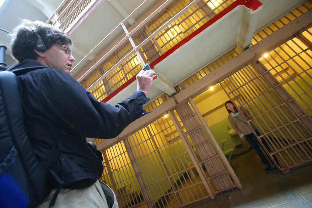 . Eric Zirbes, left, of Iowa, photographs his daughter Angela ,12, inside a prison cell at Alcatraz Island on Monday, March 18, 2013 in San Francisco, Calif. The federal prison on the island closed 50 years ago and is now a tourist destination.  (Aric Crabb/Staff)