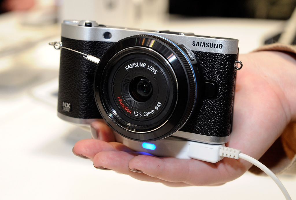 . The Samsung NX300 digital camera is seen at the 2013 International CES at the Las Vegas Convention Center on January 8, 2013 in Las Vegas, Nevada. The WiFi enabled camera is able to shoot in 2D & 3D using a specially equipped lens. (Photo by David Becker/Getty Images)