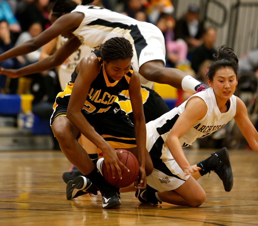 . Wilcox High School\'s D\'Airrien Jackson (25) fights for a loose ball against Archbishop Mitty High School\'s Regina Chi (13) in the second period for the CCS Open Division Girls Basketball semifinals at Oak Grove High School in San Jose, Calif., on Wednesday, Feb. 27, 2013.  (Nhat V. Meyer/Staff)