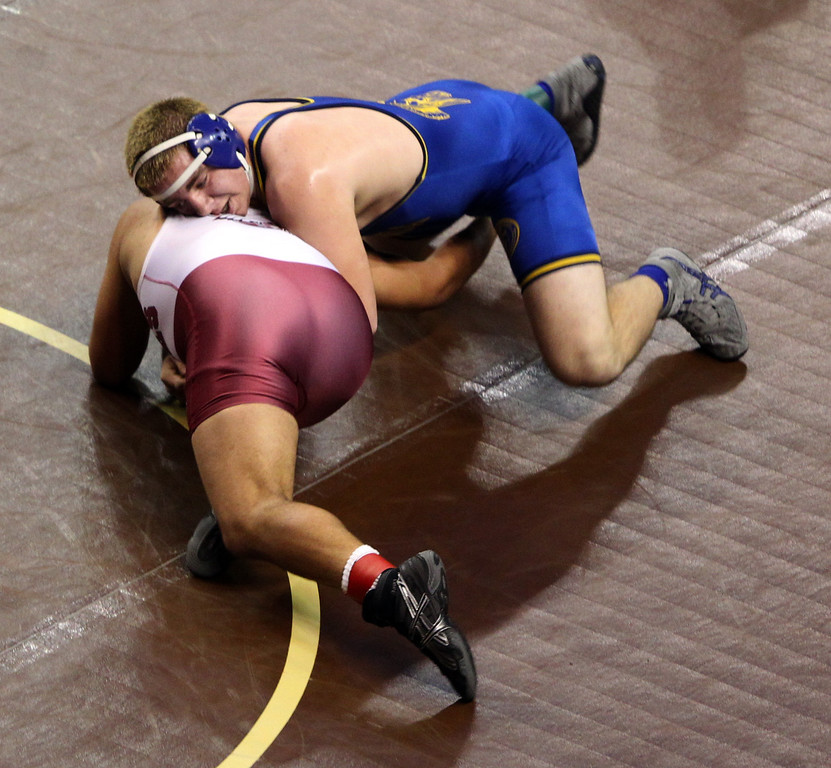 . Terra Linda\'s Nate Keeve, right, wrestles Clovis West\'s Cortes Morales in a 220-pound consolation round match during the California Interscholastic Federation wrestling championships in Bakersfield, Calif., on Saturday, March 2, 2013. Keeve would go onto win the match. (Anda Chu/Staff)