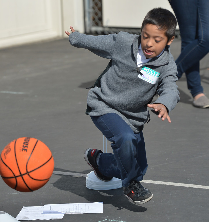 . Engenio, 9, of Antioch, swirls around as he dribbles the basketball during a Special Olympics basketball skills event at Turner Elementary School in Antioch, Calif., on Friday March 8, 2013.  (Dan Rosenstrauch/Staff)