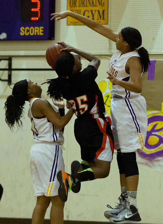 . Oakland Technical High School\'s Kelea Pickeral-Dennis, right, goes up to block a shot by McClymonds High School\'s Ahjahna Coleman (25) during the second quarter of their Oakland Athletic League girls\' basketball game, Wednesday, Feb. 20, 2013 in Oakland, Calif. McClymonds won, 62-50. (D. Ross Cameron/Staff)
