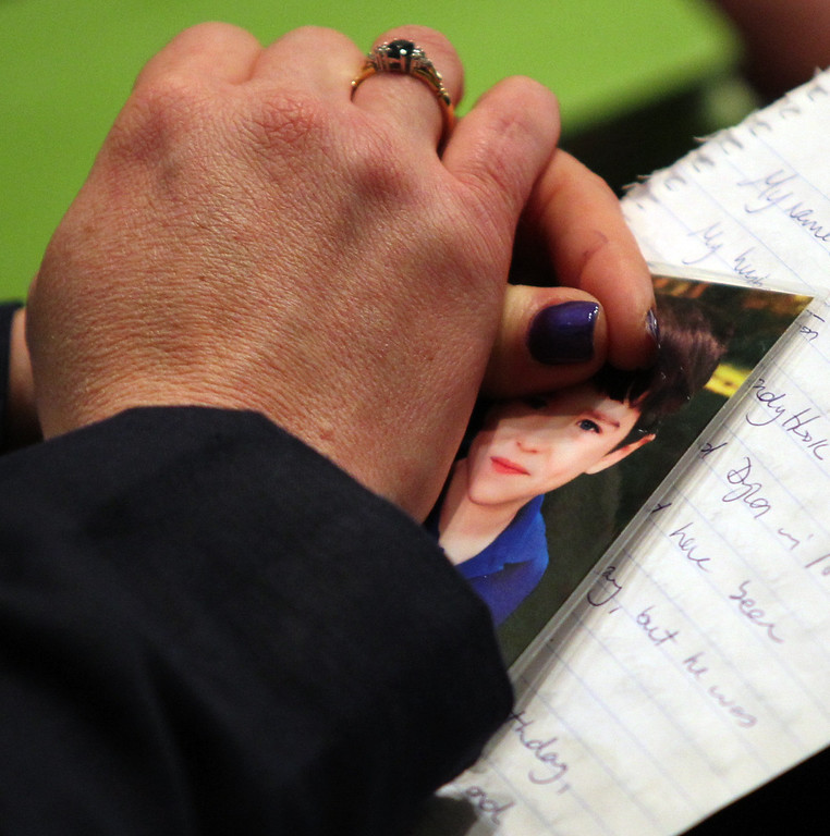 . Mother of Dylan Hockley, 6, one of the victims in the Sandy Hook school shooting, Nicole Hockley   holds onto a photo of her son Dylan while attending a news conference to launch the Sandy Hook Promise Innovation Initiative held in honor of the three month anniversary of the tragic shooting at Sandy Hook Elementary School at the Bill Graham Civic Auditorium in San Francisco, Calif., on Thursday, March 14, 2013. (Anda Chu/Staff)