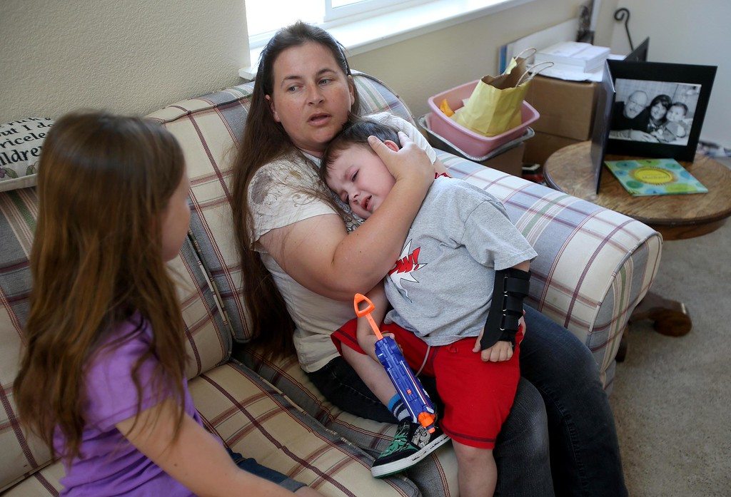 . Matthew Ouimet, 3, is comforted by his mom Kristi after falling at home in Antioch, Calif., on Friday, May 23, 2014. (Jane Tyska/Bay Area News Group)