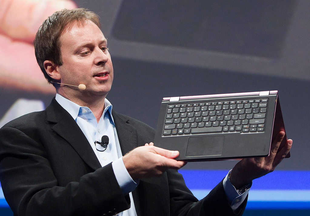 ". Kirk Skaugen, Intel\'s vice president of PC client group, converts a Lenovo Yoga Ultrabook into a tablet, at an Intel news conference during the Consumer Electronics Show (CES) in Las Vegas January 7, 2013. Intel announced improvements to its processors including one with ""all day\"" battery life. Intel also announced the availability of live and on-demand pay TV content to Intel devices. (REUTERS/Steve Marcus)"