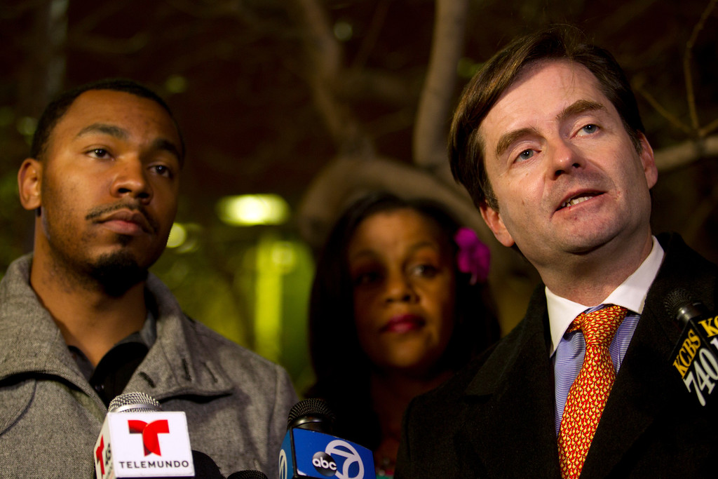 . Chris Dolan, right, attorney for the family of 13-year-old Jahi McMath, conducts a press conference with uncle Omari Sealey, left, and grandmother Sandra Chatman outside Children\'s Hospital Oakland, Monday, Dec. 30, 2013, in Oakland, Calif. A judge granted an injunction to the family to keep the girl, who is brain dead, on a ventilator until at least Jan. 7. (D. Ross Cameron/Bay Area News Group)