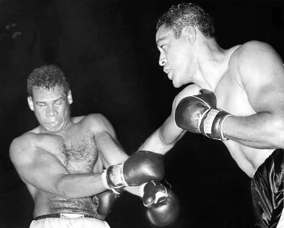 . June 1, 1959 - Paul Andrews (in black trunks) sinks a right hand to midsection of heavyweight Kolo Sabedong at the Oakland Auditorium. (Chris Kjobech / Oakland Tribune)