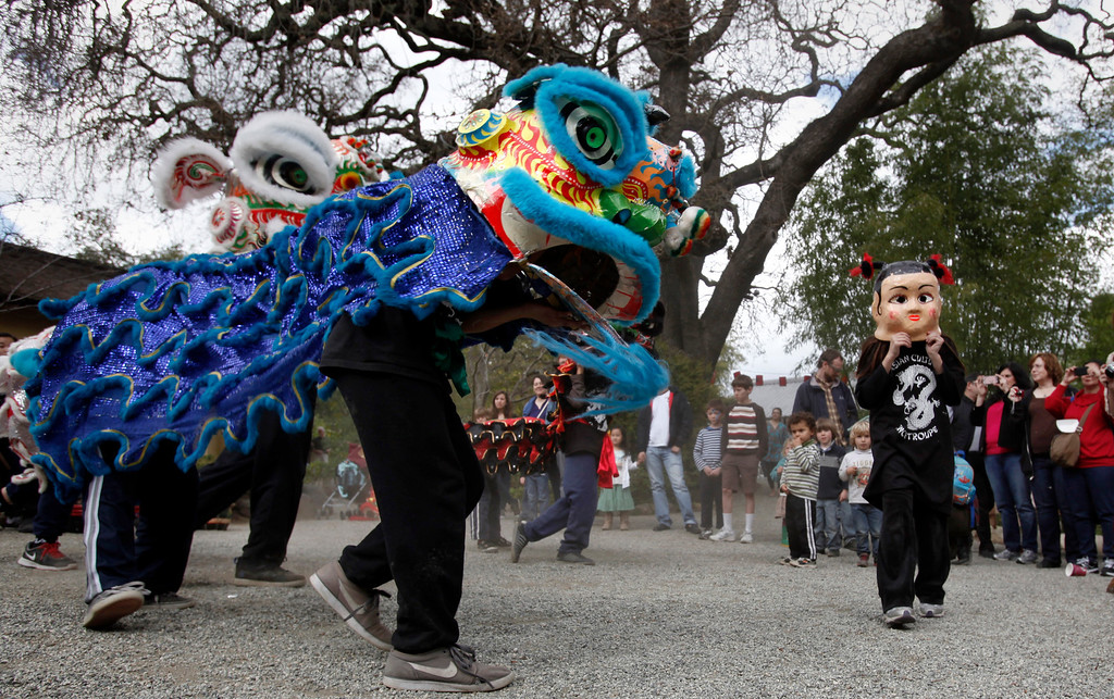 ". Dragon dancers from the Asian Cultural Dance Troupe entertain at the Hakone Estate and Gardens where a Lunar New Year of the Snake festival was hosted with a ""Chinese Village Fair\"" on Sunday afternoon, March 3, 2013 in Saratoga, Calif. (Karl Mondon/Staff)"
