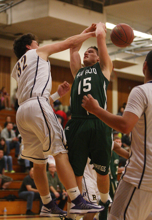. Paly\'s Mathias Schmutz has a shot blocked by Riordin\'s Zach Masoli in the second quarter at Piedmont Hills High School in San Jose, Calif. on Friday, Feb. 22, 2013.The Archbishop Riordan Crusaders played the Palo Alto Vikings in the CCS Open Division boys basketball quarterfinals. (Jim Gensheimer/Staff)