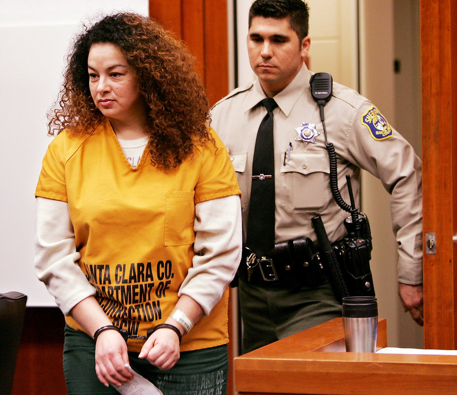 . Anna Ayala, 41, is escorted into a Santa Clara County Superior Court in a San Jose, Calif., Wednesday, Jan. 18, 2006, for a sentencing hearing. Ayala was sentenced to nine years in prison for planting a severed finger in a bowl of Wendy\'s chili in a failed attempt to extort money from the fast food chain. Her husband, Jaime Plascencia , was ordered locked up for more than 12 years. (AP Photo/Paul Sakuma)