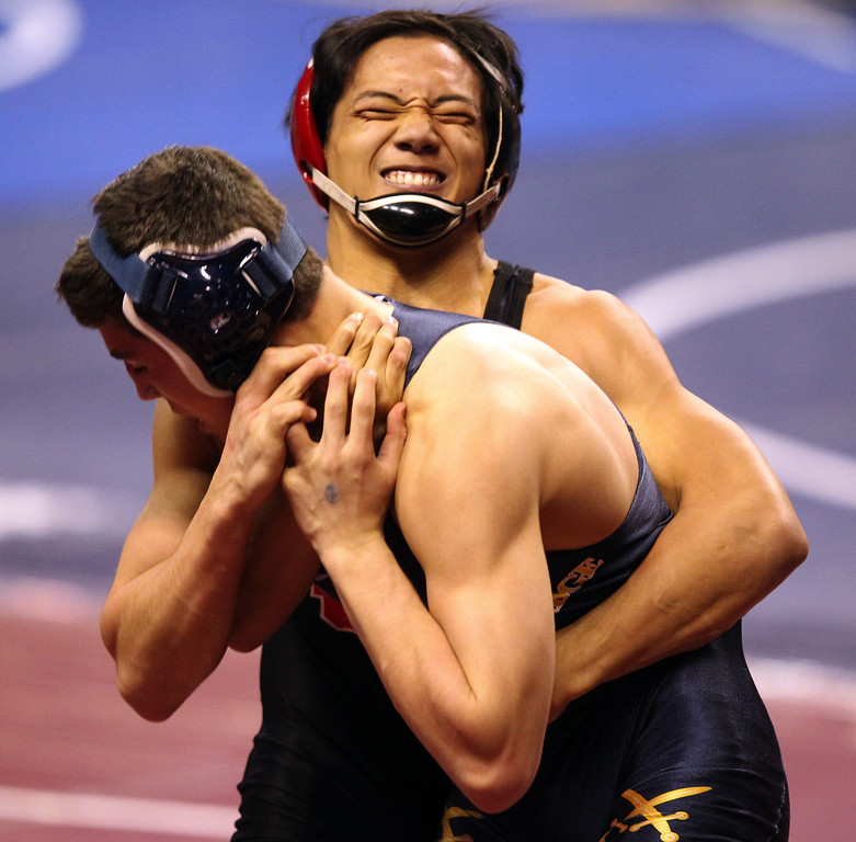 . James Logan\'s Jacob Macalolooy, right, wrestles Oak Ridge\'s Brandon Clairborne in a 138-pound first round match during the California Interscholastic Federation wrestling championships in Bakersfield, Calif., on Friday, March 1, 2013. Macalolooy would go on to win.(Anda Chu/Staff)