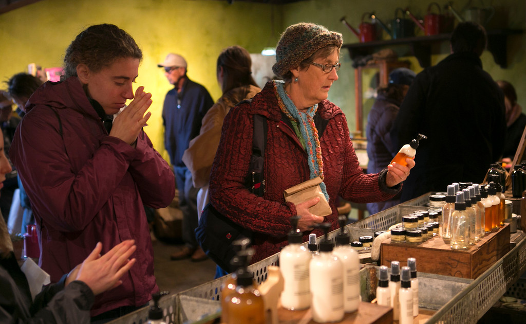 . Marilyn Conn, right, of Lindsay, Calif., looks over some of the lotions produced by Harley Farms in Pescadero, Calif.