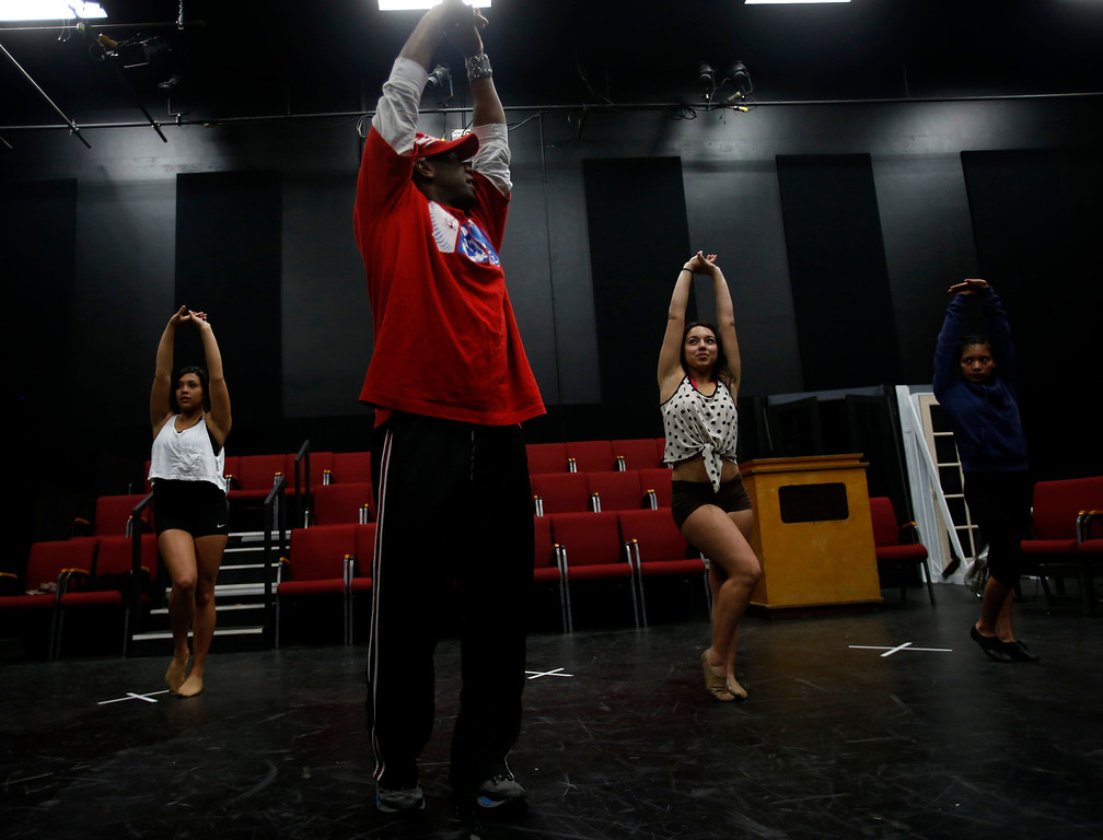 . Desi Hyter, second from left in red, choreographer for Great America, leads Marissa Gomez, far left, Marissa Dutra, second from right, and Angelique Gorospe, far right, during a dance audition during a casting call for Great America theme park for their various characters and dancers in Hall Todd Theatre at San Jose State University on Wednesday, Feb. 6, 2013.  (Nhat V. Meyer/Staff)