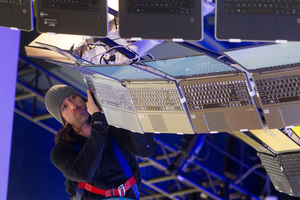 . Rigger Matt Gerbracht arranges a display of Ultrabooks powered with Intel processors as workers prepare for the International CES show at the Las Vegas Convention Center in Las Vegas, Nev., on Jan. 4, 2013. (REUTERS/Steve Marcus)