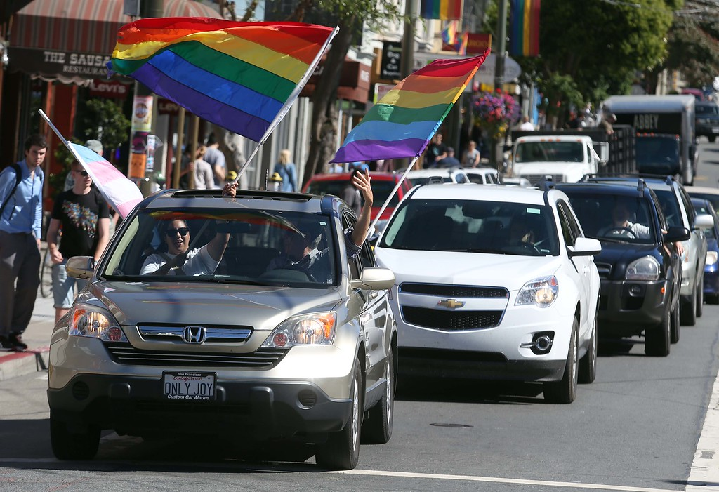 . Revelers honk their horns as they celebrate along Castro Street in San Francisco, Calif., on Wednesday, June 26, 2013. The U.S. Supreme Court dismissed California\'s Proposition 8 and declared the 1996 Defense of Marriage Act unconstitutional. (Jane Tyska/Bay Area News Group)