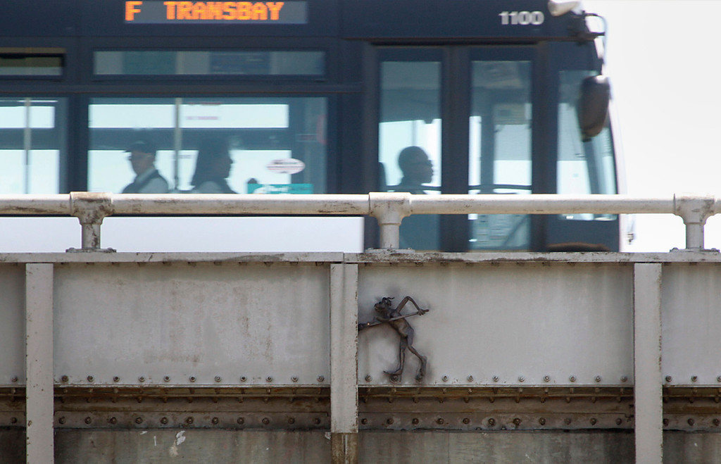 . Passengers aboard AC Transit\'s F bus ride unaware past the infamous Bay Bridge troll on Thursday afternoon May 23, 2013 into San Francisco, Calif. The troll was added by ironworkers to section of span that failed in a deadly collapse of the upper deck nearly a quarter century ago in the Loma Prieta earthquake. (Karl Mondon/Bay Area News Group)