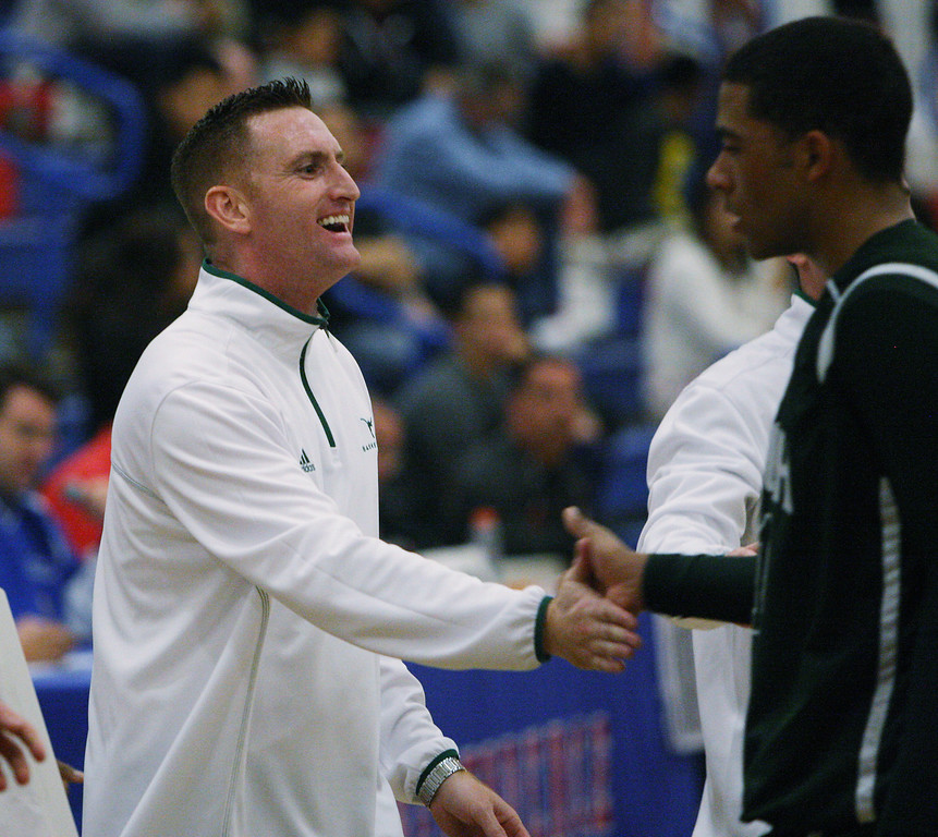 . Leigh coach Patrick Judge congratulates Devin Miller near the end of the game during the Blossom Valley Athletic League boys basketball championship game at Independence High School in San Jose, Calif. on Friday, Feb. 15, 2013. The Leigh longhorns beat the Piedmont Hills Pirates, 61-54, in overtime. (Jim Gensheimer/Staff)