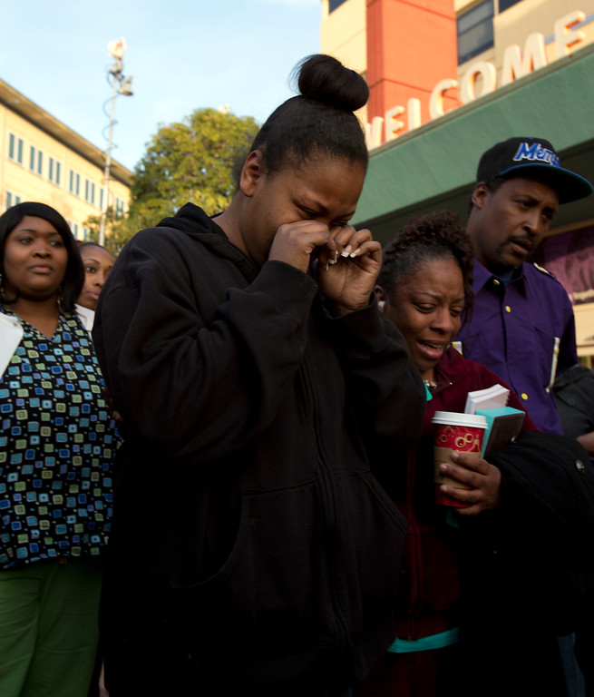 . Nailah Winkfield, center, mother of 13-year-old Jahi McMath, is comforted by family and friends outside Children\'s Hospital Oakland on Monday, Dec. 30, 2013, in Oakland, Calif. (D. Ross Cameron/Bay Area News Group)