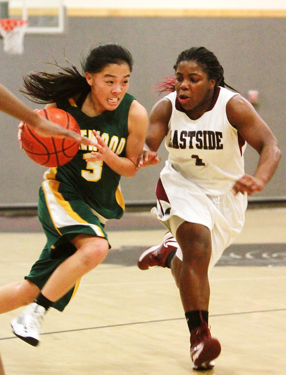 . Pinewood\'s Marissa Hing(cq) drives the ball to the hoop against Eastside Prep\'s Charmaine Bradford during a game in the second quarter at Eastside Prep High School on Tuesday, Feb. 5, 2013.     (Kirstina Sangsahachart/ Daily News)