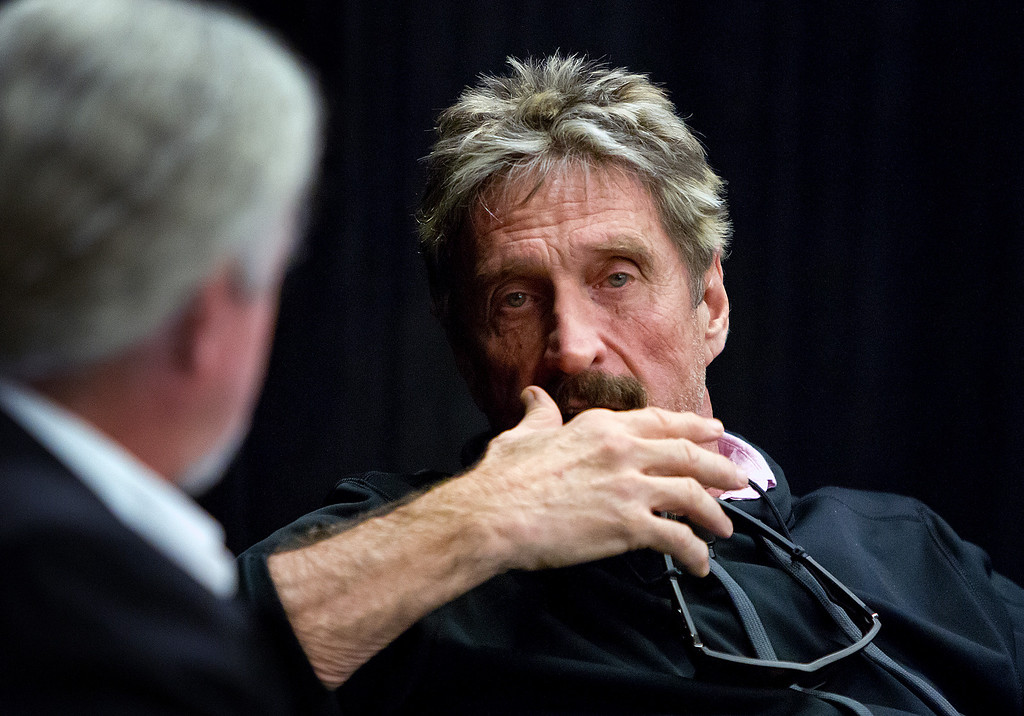 ". John McAfee, right, speaks with Dan Holden at the ""Fireside Chat with John McAfee\"" during the C2SV Technology Conference + Music Festival at the McEnery Convention Center in San Jose, Calif., on Saturday, Sept. 28, 2013.   (LiPo Ching/Bay Area News Group)"