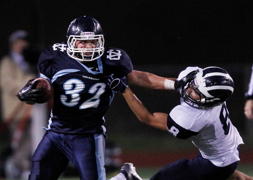 . <p>17. RYAN SEVERSON � RUNNING BACK � VALLEY CHRISTIAN-SAN JOSE</p> Severson (32) makes a run as Aptos\' Elijah Marta goes for the tackle in the fourth quarter at Independence High School in San Jose, Calif. on Saturday, December 1, 2012.  (Jim Gensheimer/Staff)