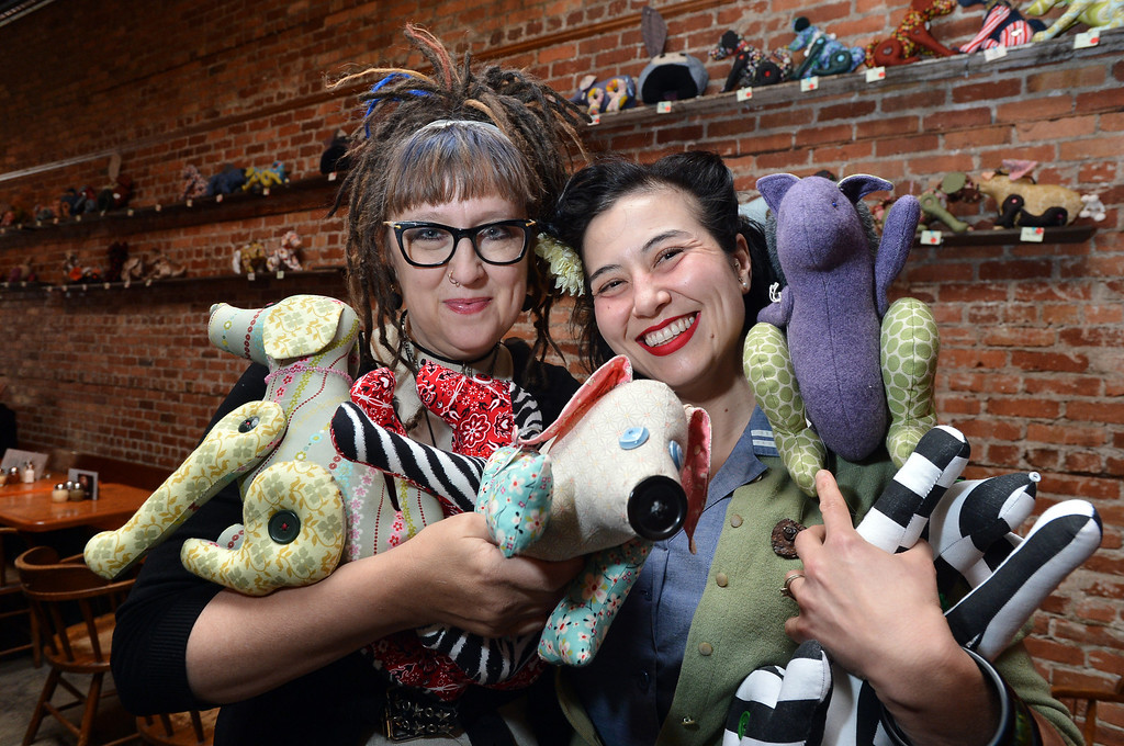 . Madeline Stanionis, left, and Alice Worland, who together are behind the Scrapyard Dogs effort to raise money for local charities, are photographed at the Lanesplitter Pizza location in Berkeley, Calif. on Monday, Jan. 28, 2013. Stanionis and Worland and others sew stuffed dogs, pigs, squirrels and other animals, then display and sell them at the restaurant and donate the money to charity. (Kristopher Skinner/Staff)