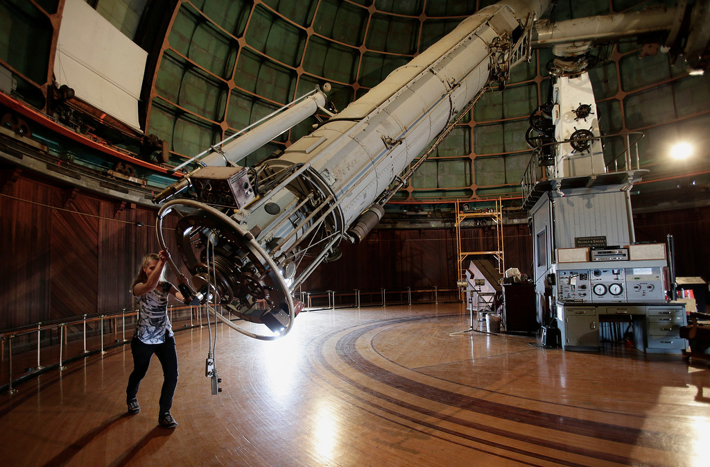 """. Astronomer Elinor Gates manually moves the 36\"""" Refractor telescope at Lick Observatory east of San Jose, Calif. on Wednesday, May 8, 2013. The observatory will be celebrating its 125th anniversary. The telescope is so delicate that there are only about a dozen people in the world that are certified to move it.  (Gary Reyes/ Bay Area News Group)"""