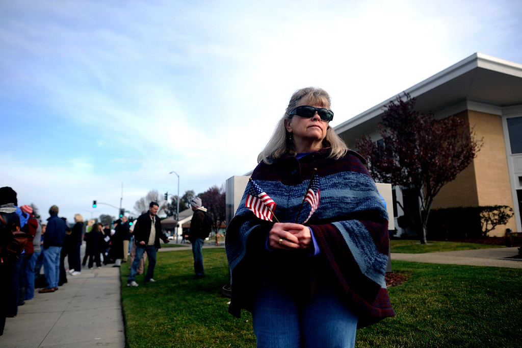 ". Mary Oldem gathers with hundreds of others on  Ocean Street at Water Street in Santa Cruz, Calif., to watch the funeral procession for detectives Sgt. Loran ""Butch\"" Baker and Elizabeth Butler on Thursday, March 7, 2013. (Matthew Hintz/Santa Cruz Sentinel)"
