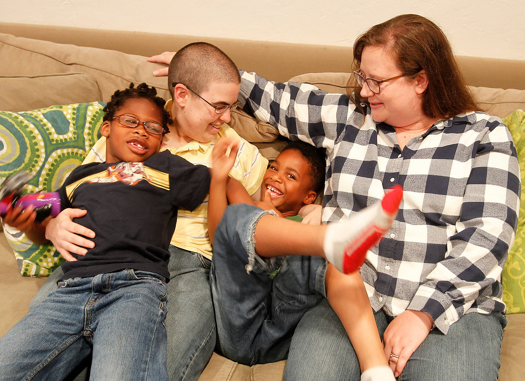 . Armoni Steehouse, left, and his brother Abijah Steenhouse, both 6, are photographed with their parents Felicia Steehouse, second from left, and Sara Steenhouse, right, in their home on Tuesday, June 25, 2013, in Oakland, Calif. (Aric Crabb/Bay Area News Group)