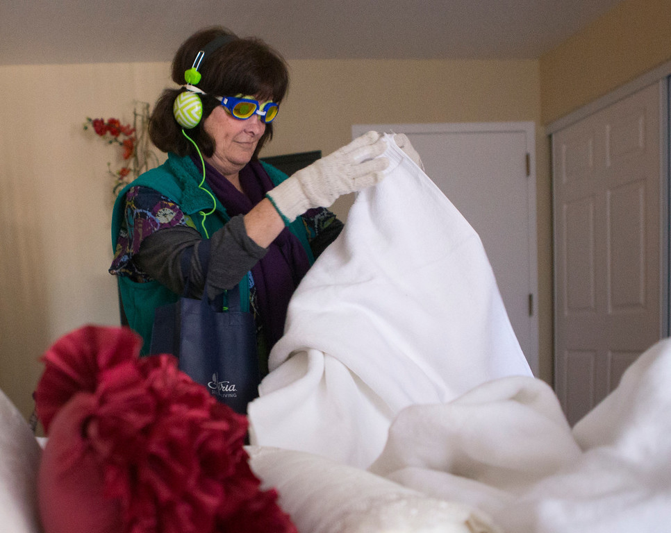 . Cathy Coolin, 61, whose mother has dementia, folds towels as she takes the virtual dementia tour at Atria Burlingame in Burlingame, Calif. on Saturday, Feb. 9, 2013. (John Green/Staff)