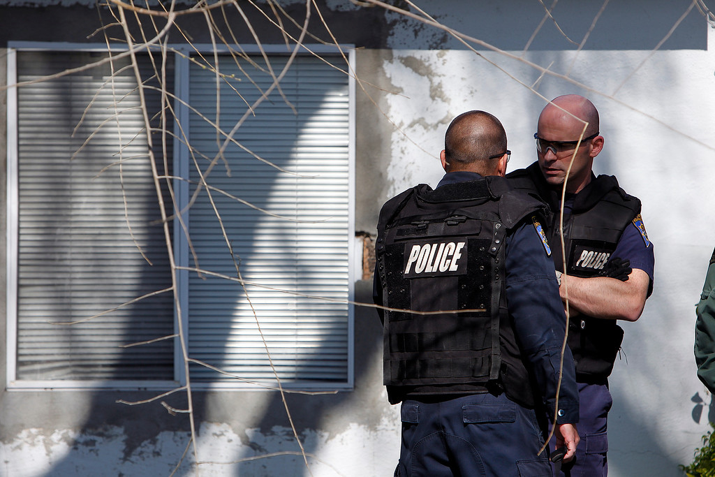 . Members of  the California Highway Patrol confer in front  Everett Basham\'s house on Humbolt Ave., during the search for explosive materials in Santa Clara, Calif. on Wednesday, Feb. 13, 2013.   (LiPo Ching/Staff)