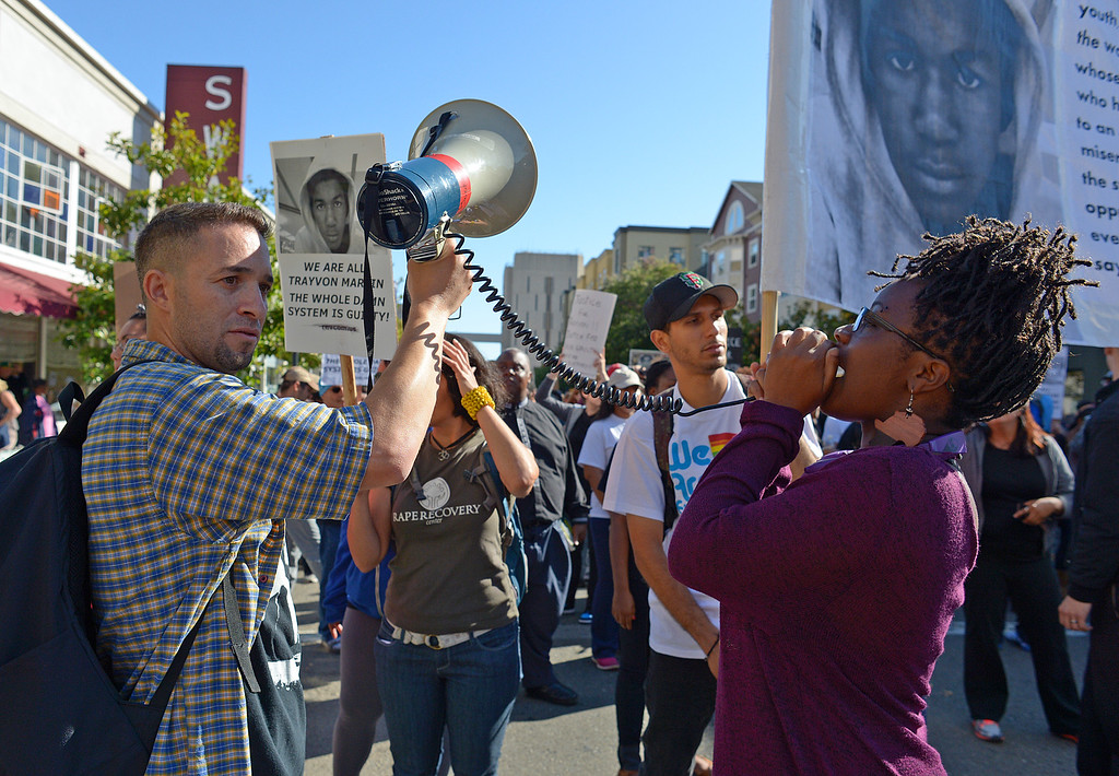 . A protester yells into a bullhorn as people chant during a march on Clay Street in Oakland, Calif., on Sunday, July 14, 2013. A Florida jury ruled Saturday that defendant George Zimmerman has been found not guilty in the shooting death of Trayvon Martin. (Jose Carlos Fajardo/Bay Area News Group)