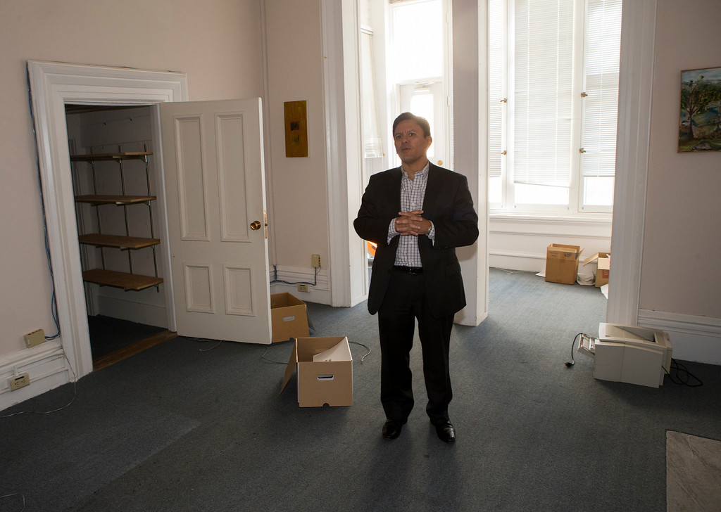 . Herman Bucheli stands in his vacated office on the third floor of Ralston Hall in Belmont, Calif., on Wednesday, Feb. 20, 2013. The upper floors of the mansion were used for Notre Dame de Namur University administration until the building was closed in 2012. (John Green/Staff)