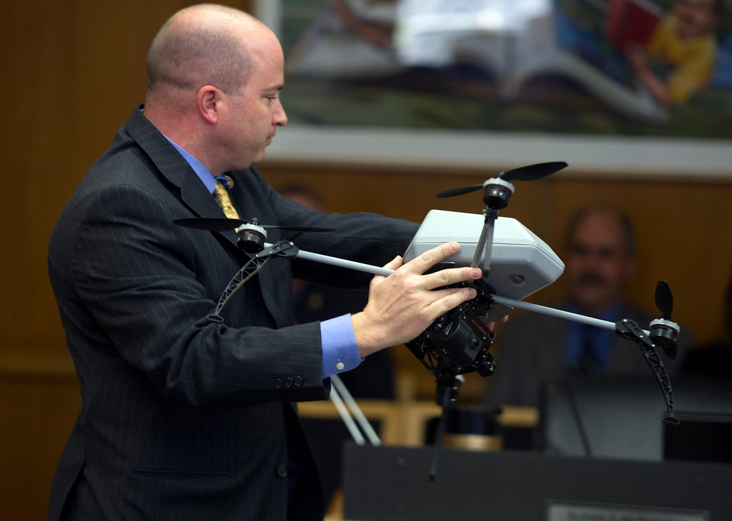 . An unidentified man holds one of the aerial surveillance drones the Alameda County Sheriff\'s department hopes to acquire, during a hearing Thursday, Feb. 14, 2013 at the Alameda County Administration Building in Oakland, Calif. (D. Ross Cameron/Staff)