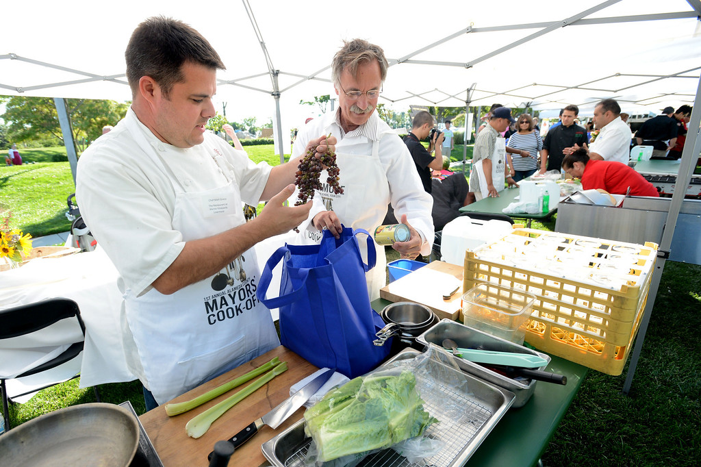 """. Matt Greco, the Chef at Livermore\'s Wente Vineyards restaurant, left, and Livermore Mayor John Marchand, look through the cooking ingredients given to them during the \""""Alameda County Mayors\' Healthy Cook-Off Challenge\"""" held at the Dublin Farmers\' Market at Emerald Glen Park in Dublin, Calif., on Thursday, July 25, 2013. The Livermore team went on to take first place advancing them to compete against the winners of the Contra Cost County Mayors\' Healthy Cook-Off Challenge. The contest will be held at Mt. Diablo High School in the fall. The cook-off was presented by Concord\'s Wellness City Challenge and promotes the importance of healthy eating. (Doug Duran/Bay Area News Group)"""