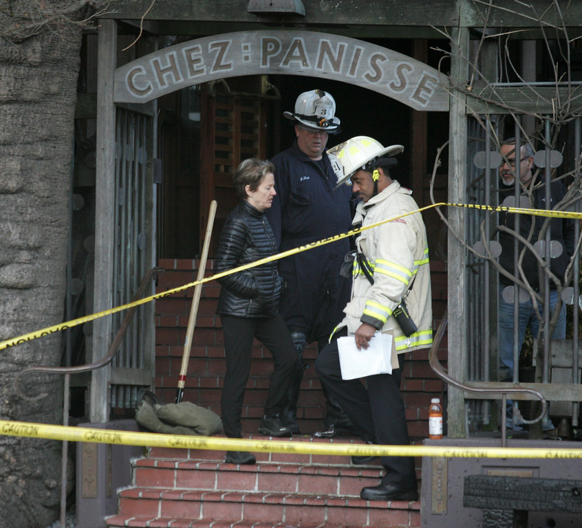 . Alice Waters, owner and executive chef of world famous Chez Panisse restaurant in Berkeley finishes a tour of her fire damaged restaurant on Friday March 8, 2013. Officials are calling the fire, which started under the front porch at about 3 a.m., suspicious. (Doug Oakley/Staff)