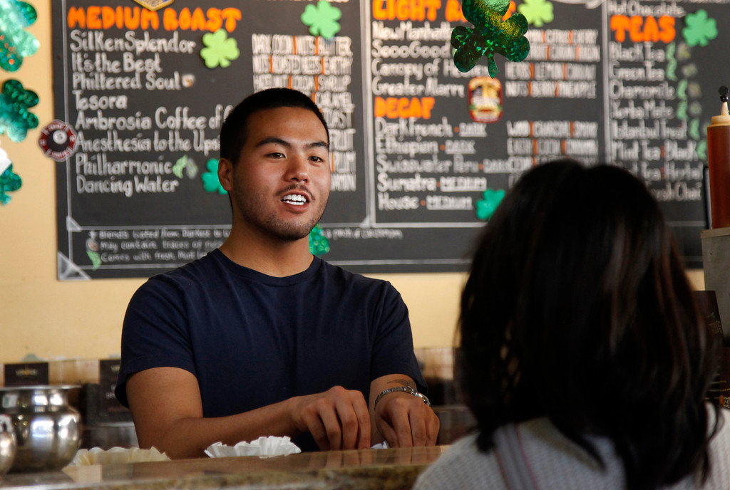 . Paolo Cui waits on a customer at Philz\' Coffee in San Jose Saturday, March 9, 2013. San Jose�s minimum wage goes into effect Mon. Mar. 11. Businesses who fought the measure are now trying to make lemons out of lemonade by trying to promote San Jose businesses as more ethical and encouraging a buy-local campaign.  (Patrick Tehan/Staff)