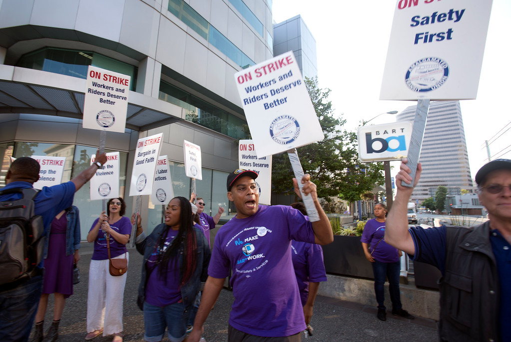 . Striking BART workers picket outside the 19th Street station on the first day of a strike by workers of the mass transit system, Monday, July 1, 2013 in Oakland, Calif. (D. Ross Cameron/Bay Area News Group)