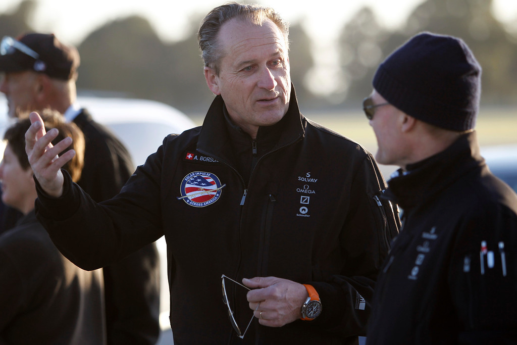 . Andre Borschberg, left, and fellow pilot Bertrand Piccard chat while waiting for the Solar Impulse, the experimental airplane, to land after a test flight at Moffett Airfield in Mountain View, Calif. Friday morning April 19, 2013.  (Patrick Tehan/Staff)