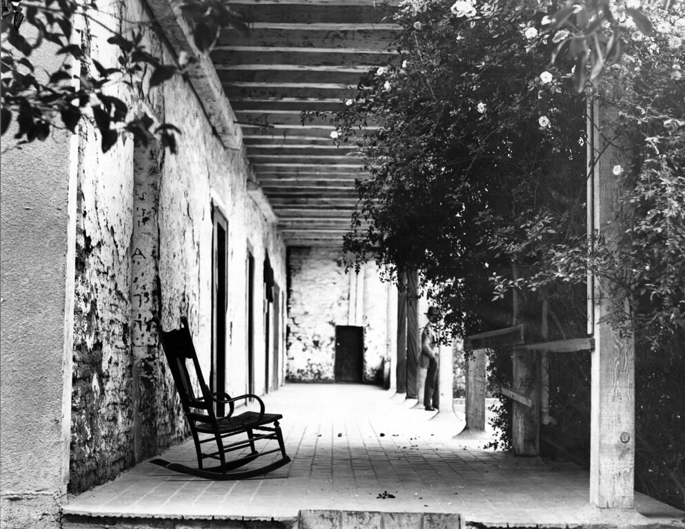 . Circa 1939 - Porch and facade of the Mission with its old adobe walls. (Oakland Tribune Staff Archives)