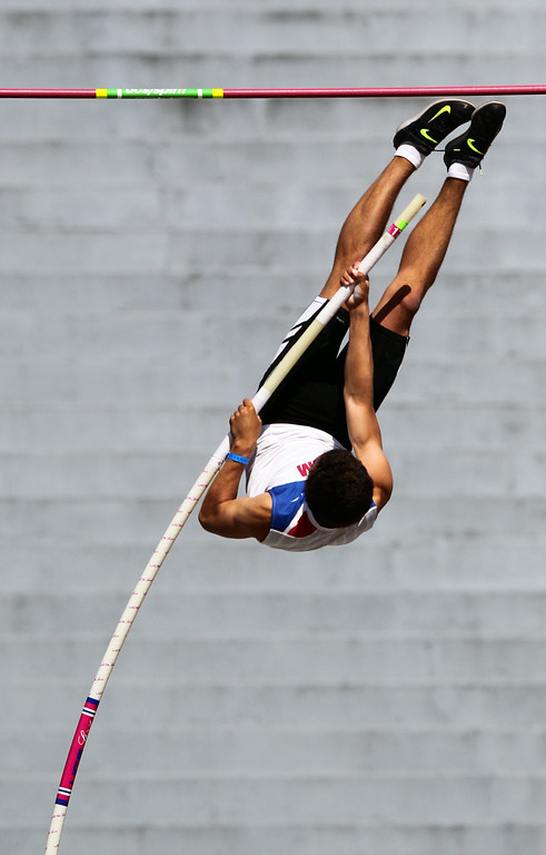 . Tamalpais\' August Kiles clears 14 feet 9 inches in the boys pole vault at the North Coast Section Meet of Champions at Cal\'s Edwards Stadium in Berkeley, Calif., on Saturday, May 25, 2013. Hutchins placed second in the race. Kiles placed first. (Anda Chu/Bay Area News Group)
