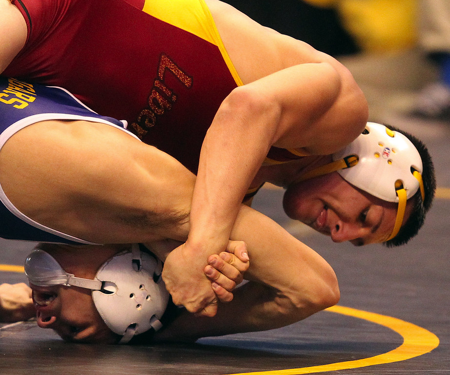 . Liberty\'s Austin Solari, top, wrestles Escalon\'s Tyler Lawrence in a 132-pound third round match during the California Interscholastic Federation wrestling championships in Bakersfield, Calif., on Friday, March 1, 2013. (Anda Chu/Staff)