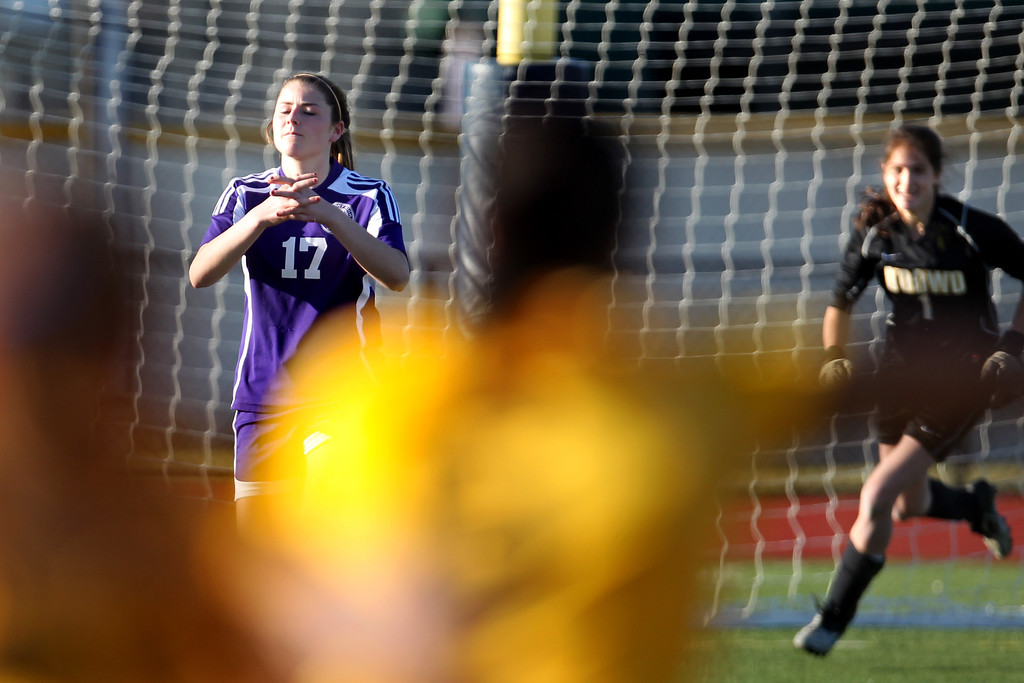 . Piedmont\'s Erin Greening (17) reacts after Bishop O\'Dowd goalie Lorna McElrath (1) dived to her left to make a save in the last penalty kick to claim the North Coast Section Division II Girls Soccer Championship at Dublin High School soccer field in Dublin, Calif., on Saturday, Feb. 23, 2013. Bishop O\'Dowd won 3-2 in a series of penalty kicks. (Ray Chavez/Staff)