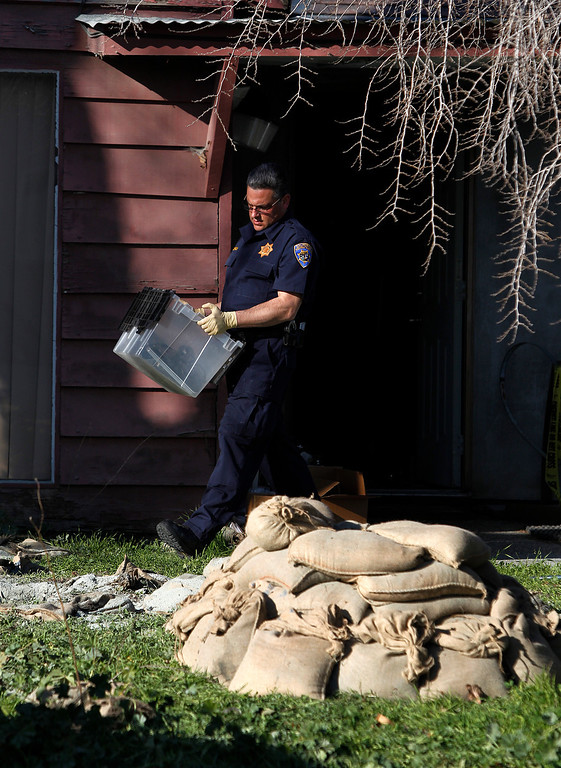 . California Highway Patrol officers remove materials found at Everett Basham\'s house on Humbolt Ave., in Santa Clara, Calif. on Wednesday, Feb. 13, 2013.   (LiPo Ching/Staff)
