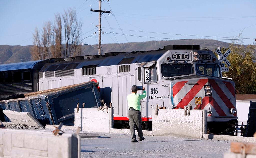 . No one was injured when a southbound Caltrain struck a big rig at a construction site at the Angus Avenue crossing at 2:30 Monday afternoon Feb. 11, 2013 in downtown San Bruno, Calif.  (Karl Mondon/Staff)