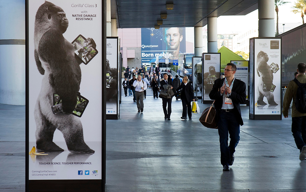 . A man walks by an advertisement for Corning Gorilla Glass 3 outside the Las Vegas Convention Center on the first day of the Consumer Electronics Show (CES) in Las Vegas January 8, 2013. (REUTERS/Steve Marcus)