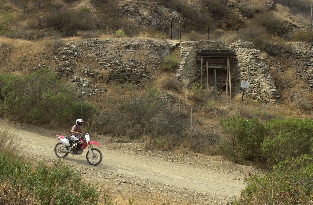 ". A dirt bike rider makes his way along the Kiln Canyon Trail, which passes an old brick kiln posted as an ""Archeological Resource Area\"" at the Carnegie State Vehicular Recreation area on Sept. 7, 2003, in the Tesla area of Livermore, Calif. (Susan Tripp Pollard/Staff Archives)"