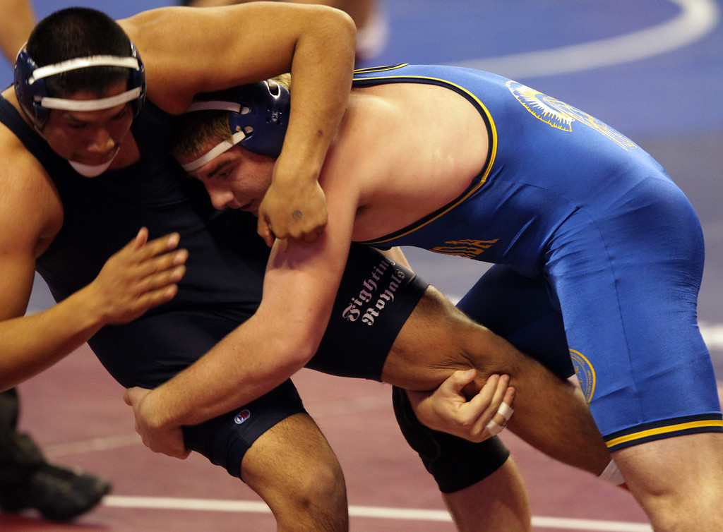 . Terra Linda\'s Nate Keeve, right, wrestles Overfelt\'s Jairo Rocha in a 220-pound second round match during the California Interscholastic Federation wrestling championships in Bakersfield, Calif., on Friday, March 1, 2013. Keeve would go on to take the win and move to the third round. (Anda Chu/Staff)