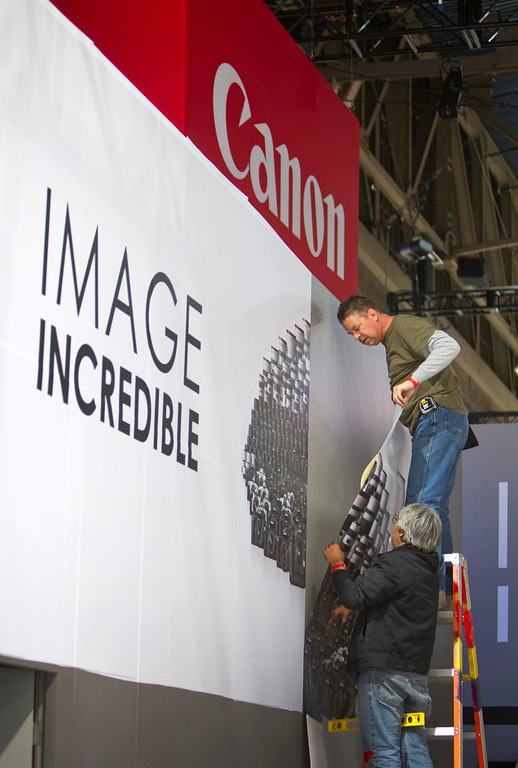 . Workers set a booth for Canon cameras for the International CES at the Las Vegas Convention Center in Las Vegas, Nev., on Jan. 5, 2013. (REUTERS/Steve Marcus)